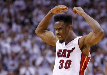 Heat's Cole celebrates after scoring the go ahead basket against the Bulls during the fourth quarter in Game 5 of their NBA Eastern Conference semi-final basketball playoff in Miami