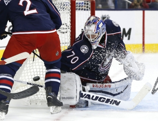 Sep 21, 2015; Columbus, OH, USA; Columbus Blue Jackets goalie Joonas Korpisalo (70) makes a blocker save in net in the first period against the Pittsburgh Penguins at Nationwide Arena. Mandatory Credit: Aaron Doster-USA TODAY Sports